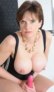 mature slut with big round fake tits